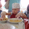<b>Submitted By:</b> Kathryn Bandstra <b>From:</b> Traverse City MI <b>Description:</b> Four year old Josie Stites making a pie at the Childrens Pie Baking session today.