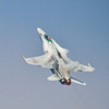 <b>Submitted By:</b> Peggy Sue Zinn <b>From:</b> Traverse City <b>Description:</b> FA18 with vapor trails and afterburner.