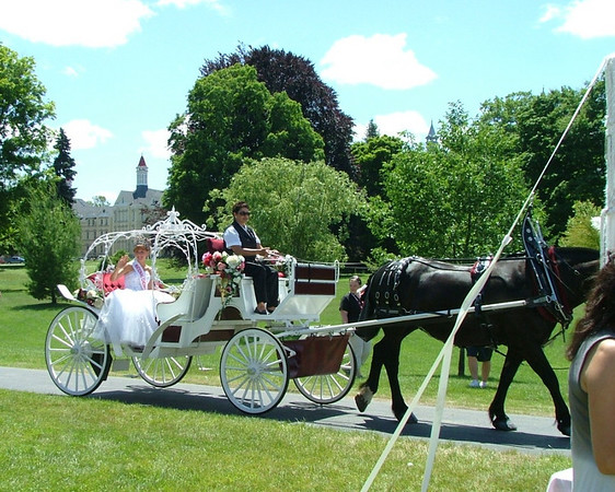 <b>Submitted By:</b> Diane Budzynowski <b>From:</b> Traverse City <b>Description:</b> Cherry Queen arrives in style to the Princess Tea on Monday, July 6th. Building 50, in the background, looks like a fairy tale castle.