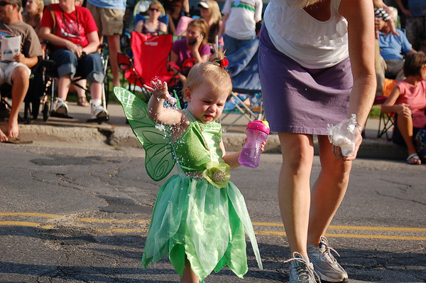 "<span style=""display:none"">Email: smelton40@yahoo.com</span> <b>Submitted By:</b> Susan Melton <b>From:</b> Beulah <b>Description:</b> Tinkerbell sprinkles the crowd with pixie dust during the National Cherry Festival Jr. Royal Parade."