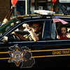 "<span style=""display:none"">Email: tiny.leviathan@gmail.com</span> <b>Submitted By:</b> Levi Gates <b>From:</b> Traverse City <b>Description:</b> A small child waves from the back of a police cruiser during the parade on July 7th, downtown Traverse City."