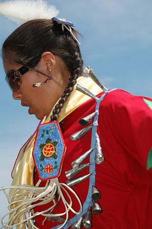 "<span style=""display:none"">Email: smelton40@yahoo.com</span> <b>Submitted By:</b> Susan Melton <b>From:</b> Beulah <b>Description:</b> Julia Martell from Traverse City dances into Grand Entry during the Grand Traverse Band Pow Wow during National Cherry Festival Heritage Day 2011."