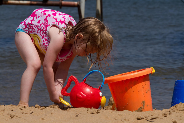 <b>Submitted By:</b> Peggy Zinn <b>From:</b> Traverse City <b>Description:</b> Playing on the Beach while Air Show flies over head