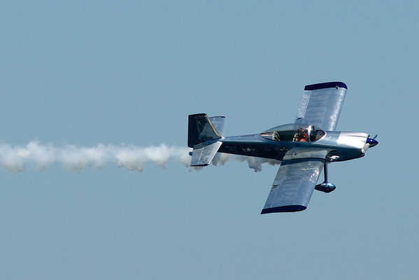 """<b>Submitted By:</b> Jason Lome <b>From:</b> Traverse City <b>Description:</b> Joe """"Rifle"""" Shetterly is flying a home brew aircraft. Taken from the mast of the Nauti-cat during the Cherry Festival air show."""