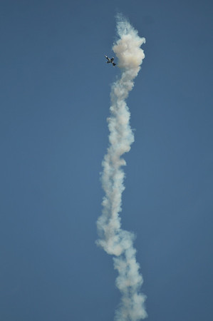 <b>Submitted By:</b> Ralph Epifanio <b>From:</b> Deland, Florida <b>Description:</b> Out of Gas, but not gasps; feigning a flame-out during the 2011 TC Air Show, a jet falls back down through its own exhaust toward the waters of Grand Traverse Bay, far below. Credit: Ralphoto