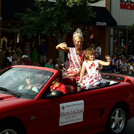"<span style=""display:none"">Email: tiny.leviathan@gmail.com</span> <b>Submitted By:</b> Levi Gates <b>From:</b> Traverse City <b>Description:</b> Cherry Queen Maria LaCross waves to the crowds during the parade on July 7th, downtown Traverse City."