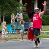 "<span style=""display:none"">Email: cathy@lindylazar.com</span> <b>Submitted By:</b> Cathy Nelson <b>From:</b> Williamsburg, Michigan <b>Description:</b> Chair-y Festival Drill Team Member, Darryl Nelson, waves to fans during the Cherry Royale Parade."