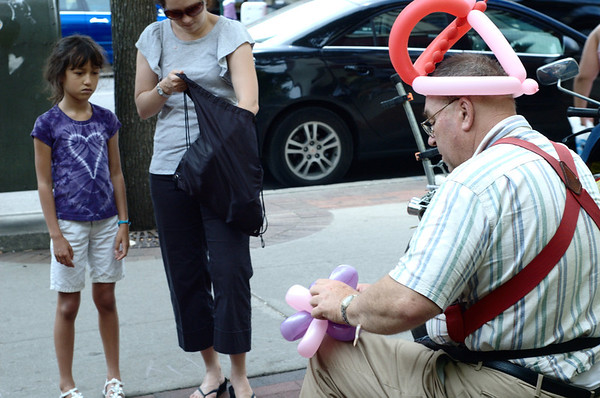 "<span style=""display:none"">Email: tiny.leviathan@gmail.com</span> <b>Submitted By:</b> Levi Gates <b>From:</b> Traverse City <b>Description:</b> A street vendor makes a balloon animal, July 5th, Front St between Cass and Union"