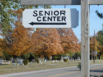 """ Senior Center"" - I saw this cute paradox while coming into Mackinaw City<br /> in the fall of 2003, and couldn't resist driving back up there to take this<br /> photo at a later date. As a Senior myself, I hope that my visit to a ""Senior<br /> Center"" won't be a cemetery, at least in the short run, as this sign<br /> implies.<br /> <br /> Bill Scott<br /> bshm@charter.net"