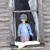 Figure in window of old abandoned house appears very rarely and only to <br /> select individuals.<br /> This lucky shot provides evidence to those that never believed.<br /> <br /> John Novosad<br /> Houghton Lake