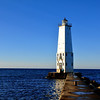 <b>Submitted By:</b> Steve Nowakowski <b>From:</b> Lambertville, MI. <b>Description:</b> Frankfort Pier Light on a calm fall day in 2010, located in Frankfort, MI.