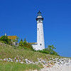 <b>Submitted By:</b> Steve Nowakowski <b>From:</b> Lambertville, MI. <b>Description:</b> South Manitou Island Lighthouse taken from the shoreline of South Manitou Island.