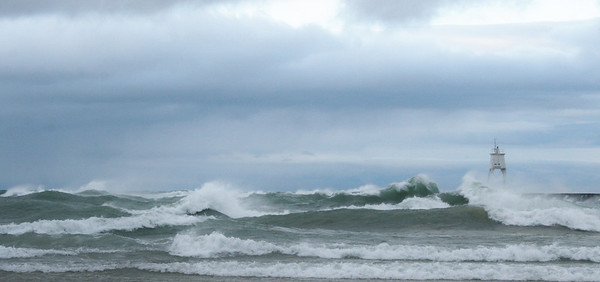 <b>Submitted By:</b> Sharon Lea Mitchell <b>From:</b> Kingsley Michigan <b>Description:</b> Gale winds on Lake Superior. Grand Marais outer lighthouse October 2011