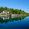 <b>Submitted By:</b> Jim Miller <b>From:</b> Omena <b>Description:</b> A yacht club on glassy Omena Bay