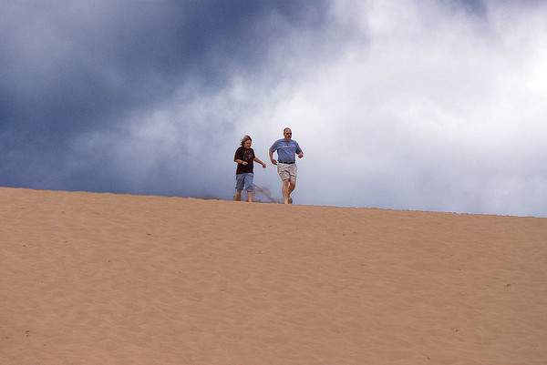 William DeCamp and daughter Rebecca (age 11) of Williston, Vermont jog on <br /> the Sleeping Bear dune.  Photo taken on 8/10  by Peter DeCamp, Chicago, <br /> Illinois