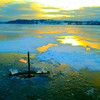 <b>Submitted By:</b> Kyle James Broadway <b>From:</b> Traverse City <b>Description:</b> Ice fishing one of the many beautiful inland lakes of Traverse City. In hot persuit of predatory Northern Pike armed with Tipups and live bait on Christmas Eve Night.