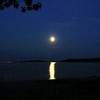 Erv Liechti<br /> Jackson, Michigan<br /> <br /> Taken early morning of July 29, 2007 Moon over Power Island and NeahTaWanta <br /> Point. Traverse City in background. Canon A70 Camera.