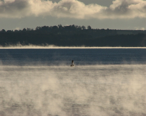 "<b>Submitted By:</b> David P Williams <b>From:</b> Suttons Bay <b>Description:</b> First Hard Frost, October 4.  GT West Bay ""steaming"" off Lee Point with R4 buoy & Old Mission Peninsula."