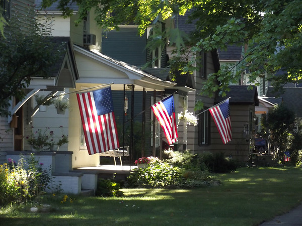 <b>Submitted By:</b> Sandy Coleman <b>From:</b> Traverse City <b>Description:</b> Flags proudly displayed on West Tenth Street in Traverse City Monday morning