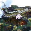 <b>Submitted By:</b> Catherine Schoech <b>From:</b> Traverse City <b>Description:</b> I took this picture on 3/3/12. near my home in Traverse City. St. Patricks Day is coming up soon and I thought some photography of my favorite necklace would tie in well!