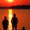 <b>Submitted By:</b> david skop <b>From:</b> boyne falls <b>Description:</b> Three people watching the sunset in Boyne City