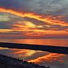 <b>Submitted By:</b> Steve Nowakowski <b>From:</b> Lambertville, Michigan <b>Description:</b> Sunset on Lake Superior shoreline from inside Muslallonge Lake State Park in the summer of 2011.
