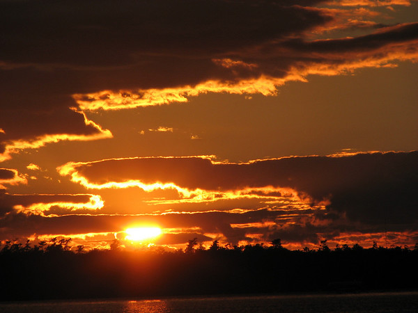 <b>Submitted By:</b> Mary Hartz <b>From:</b> Grawn <b>Description:</b> Sunset over Duck Lake, Summer 2010