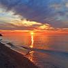 <b>Submitted By:</b> Steve Nowakowski <b>From:</b> Lambertville, Michigan <b>Description:</b> Sunset over The Lake Superior Shoreline from inside Muskallonge Lake State Park in the summer of 2011.