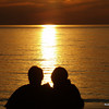 <b>Submitted By:</b> Rick Desrochers <b>From:</b> Orlando <b>Description:</b> a couple watching the sunset on Empire Beach