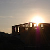 <b>Submitted By:</b> Casey Leach <b>From:</b> Traverse City <b>Description:</b> Sunset through construction on a new house.