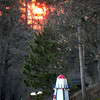 <b>Submitted By:</b> Dan Erickson <b>From:</b> Traverse City <b>Description:</b> Sunset fire in the trees on Silver Lake.