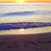 <b>Submitted By:</b> Rick Desrochers <b>From:</b> Orlando <b>Description:</b> Writing in the sand at sunset on Empire Beach