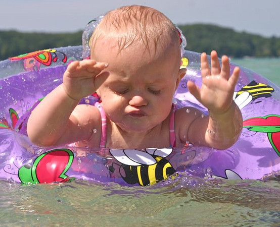 <b>Submitted By:</b> Mark Width <b>From:</b> Rapid City <b>Description:</b> Another first.... Here Jordan Cowan (age 10 months) takes her first swim ever.... at the sand bar in Torch Lake. 8/10/2010.