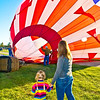 <b>Submitted By:</b> Peggy Sue Zinn <b>From:</b> Traverse City <b>Description:</b> Daughter watches on with Mom, and Dad inflates the ballon at Midland Hot Air Ballon Festival
