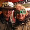 "<b>Submitted By:</b> Dean Bull <b>From:</b> Traverse City, Michigan <b>Description:</b> Sandie and Dean Bull in front of the State Theater just before midnight on New Year's Eve. On the hat it says ""2010"" The sign on the theater says, ""Coming soon"". Coinsidence can be fun..."