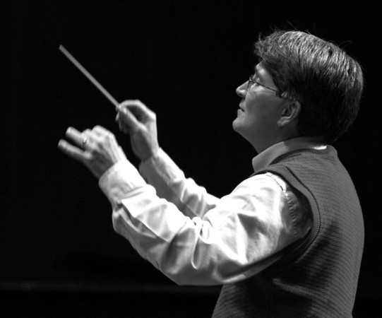 Pat Brumbaugh, TC West HS Band Director, conducting the Interlochen National <br /> Symphonic Band in concert in Corson Auditorium July 2007.<br /> <br /> Photo by Jim Schoensee<br /> Central Lake, MI<br /> Canon Rebel XT<br /> Canon 70-200 2.8 IS lens<br /> ISO 400<br /> F 4.0<br /> 1/125th second