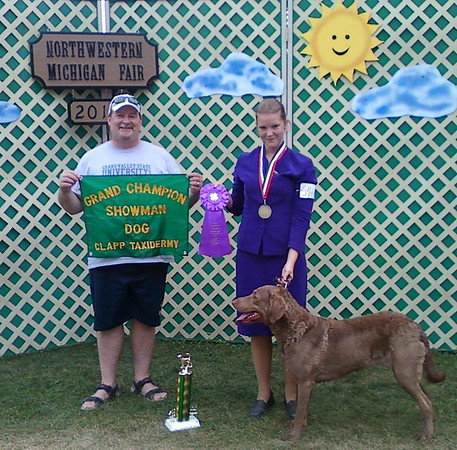 <b>Submitted By:</b> Karen J. Hall <b>From:</b> Suttons Bay <b>Description:</b> 2010 Grand Champion in Dog Showmanship, my daughter Carrie, 15 with her Chesapeake Bay Retriever Zoey and Leader of 4-Legged Friends 4H Dog Club, my Husband Mark Hall