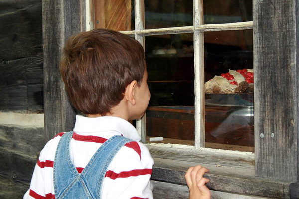 """Nolan Sparks admiring the """"pie"""" at the Hessler House, Old Mission lighthouse<br /> <br /> Photographer's Name: Natalie Okerson-Sparks<br /> Photographer's City and State: Traverse City, MI"""