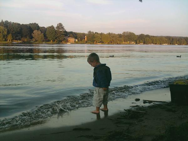 <b>Submitted By:</b> George Molski <b>From:</b> Mancelona <b>Description:</b> Fourth generation camper Tucker Molski enjoying the beach on at Thurston Park, Central Lake, MI