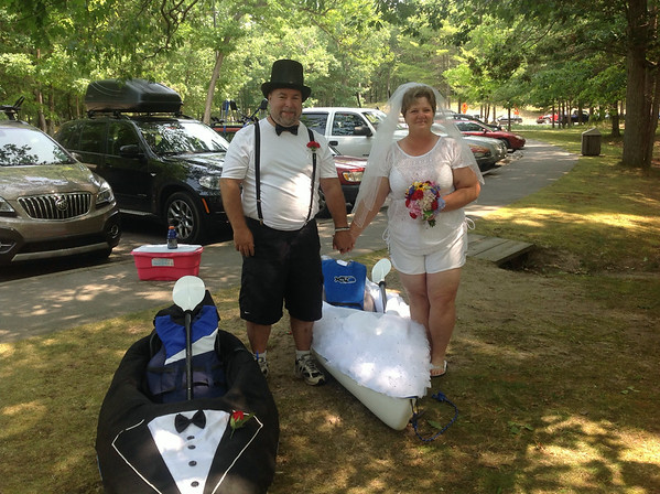 John and Sally, preparing to go down the Platte River to get married on Loon Lake  8/2/14<br /> <br /> Photographer's Name: Carol Young<br /> Photographer's City and State: Ann Arbor, MI
