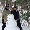Chany & Lisa Jeanguenin, from California, took time out from their vacation to build a snowman in Interlochen!<br /> <br /> Photographer's Name: mona alpers<br /> Photographer's City and State: interlochen, MI