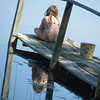 <b>Submitted By:</b> TARA WELCH <b>From:</b> KALKASKA <b>Description:</b> My daughter sitting on our dock