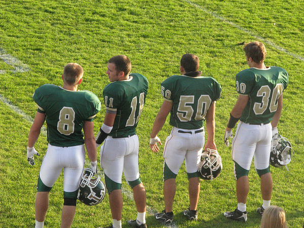 Attached is a picture of four Traverse City West Titans (Cam Howard, John <br /> Purdy, Brad Gillison, and Jon Flynn)  at Thirlby Field!