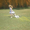 "<b>Submitted By:</b> Joan Hughes <b>From:</b> T.C. <b>Description:</b> ""Cassie and Charley"" (5-yr old Cassie and 4-mo. old Charley enjoying a run in my back yard - July 2009)"