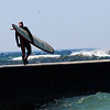 Robert Stucky<br /> Traverse City<br /> <br /> This photo was taken in Frankfort Mi on wed the 20th of May, 2009.<br /> Surfer walking the pier