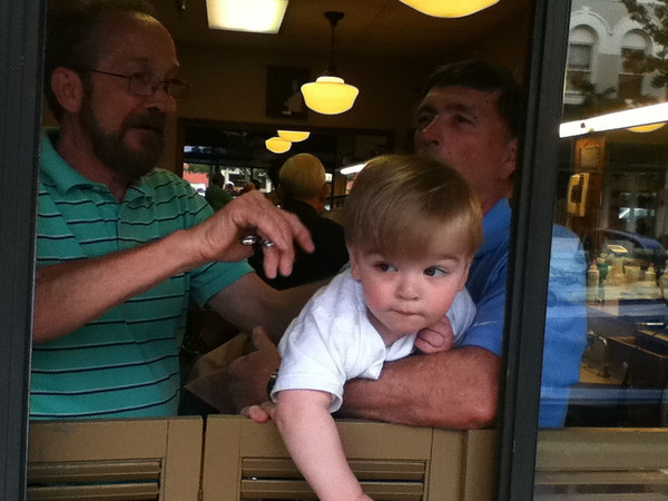 <b>Submitted By:</b> Michelle Foresman-Cooper <b>From:</b> Grosse Pointe Park <b>Description:</b> Retired district judge, John Foresman hangs on as his grandson, Brady, checks out Union Street. Roger from Robertson's cuts Brady's hair.