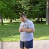 """ The many faces of Autism"". This is a photo of our grandson, Christopher, <br /> who is now 23 years old and lives with my wife and I here in Traverse City. <br /> We are his grandparents and his guardians. This photo shows Christopher on <br /> one of our many walks, this particular one around the old State Hospital <br /> grounds. He and I walk about 15 or 20 miles per week. My purpose in sharing <br /> it is to display the smile on his face and the fact that we rarely see <br /> anybody out in the community with their special needs kids, and young <br /> adults. I would like to invite moms and dads, grandpas and grandmas, and <br /> other family members to get involved with their special needs kids and take <br /> them for walks, rides, trips, etc. instead of just warehousing them at home <br /> and expecting them to be happy about that. All people need interaction and <br /> the love that comes back from them in return is priceless.<br /> <br /> Bill Scott<br /> bshm@charter.net"