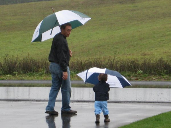 <b>Submitted By:</b> Charles William Schwarz <b>From:</b> Traverse City <b>Description:</b> My 20 month old son Charlie wanted to go outside but it had been raining for 3 days. So I grabbed the umbrellas and out we went.