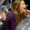 Second grader Samantha Mosher is having a blast dancing with her cousin and <br /> the other cheerleaders at her first basketball game one Friday evening in <br /> mid-December, 2008.<br /> <br /> Photo by Jim Schoensee<br /> Central Lake, MI<br /> Canon 50 D camera<br /> Sigma 18-50 2.8 mm lens<br /> 2000 ISO<br /> f 3.2<br /> 1/500th sec.<br /> Selective coloring in Photoshop CS2<br /> Soft Focus in Picasa