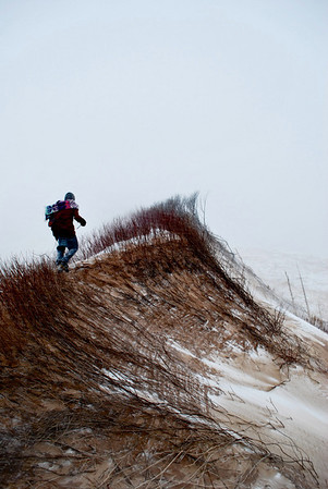 Hi my names Leland Wynkoop, I live in Traverse City Michigan. This photo, <br /> entitled 'Sand Strider' depicts a man on an exploration through the Sleeping <br /> Bear Dunes.